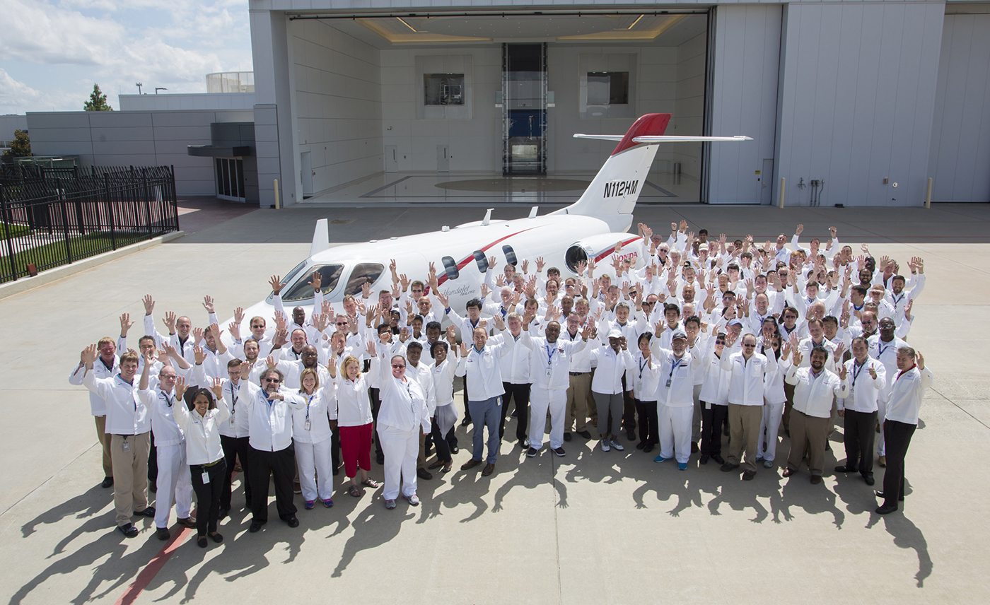 Honda Aircraft Company associates celebrate the delivery of the first HondaJet Elite. (PRNewsfoto/Honda Aircraft Company)