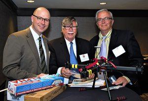 From left, representing AMA are, Chad Budreau, Gordan Schimmel and Bill Pritchett.
