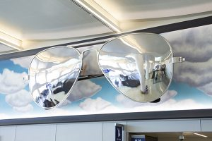 "Donald Lipski's ""Aviators"" are giant sunglasses on the wall of the arrivals atrium."