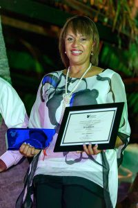 Director General in The Bahamas Ministry of Tourism and Aviation, Joy Jibrilu, accepting the award.