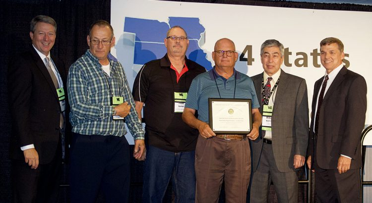 North Platte, NE was recognized with a Part 139 Safety Award. Pictured from left are FAA Deputy Regional Administrator John Speckin, Randy Haessier, Rick Barton, Jim Backenstose, Mike Mullen and Jim Johnson.