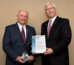 "Executive Director Charles T. ""Skip"" Miller, left, receives the AAAE Distinguished Service Award from Scott Brockman at the Louisville Regional Airport Authority monthly Board of Directors meeting on Wednesday, June 21, 2017."