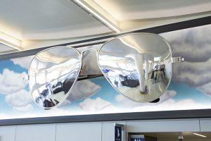 "Donald Lipski's ""Aviators"" are giant sunglasses on the wall of the arrivals atrium."