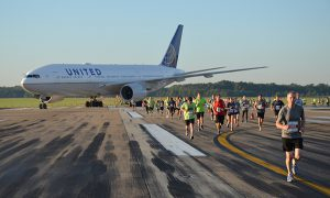 A United 777 provides a backdrop to Run the Runway at Dulles International Airport.