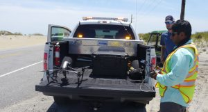 NCDOT crew preparing to use a drone to photograph Hatteras Island in July 2017