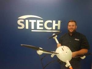 SITECH South's UAS/ Advanced Technology Specialist Matt Rosenbalm holds a Microdrones mdMapper1000DG. (PRNewsfoto/Microdrones)